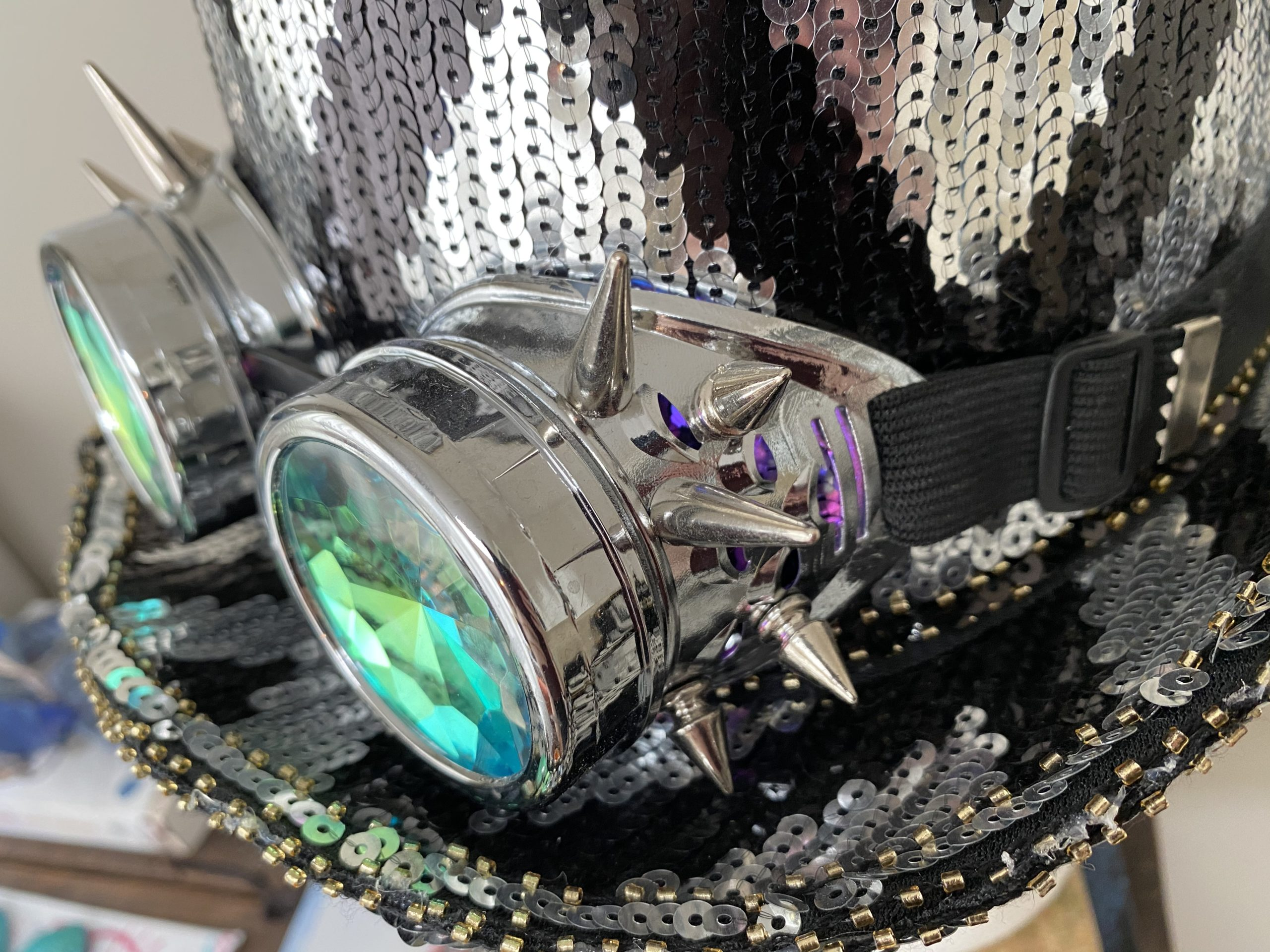 Black and white sequined top hat with googles